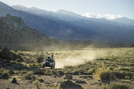 Sports utility vehicle on field against Alabama hills - CAVF23487