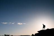 Silhouette of man standing on mountain against sky - CAVF23862