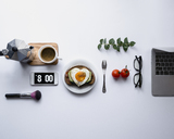 Overhead view of breakfast with accessories against white background - CAVF24285