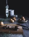 Button mushrooms with onion and knife on cutting board - CAVF24336