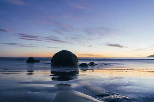 Rocks in sea against sky during sunset - CAVF24471