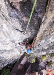 Thailand, Krabi, Tonsai beach, woman climbing in rock wall - ALRF01030