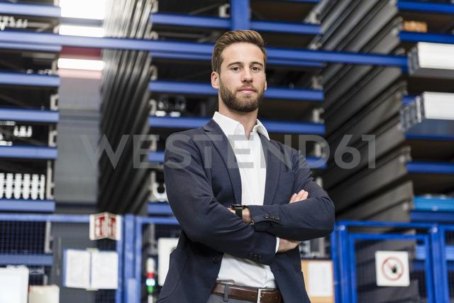 Smiling businessman in storage - DIGF03530