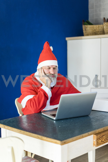 Frustrated Santa using laptop at home - MOEF00993