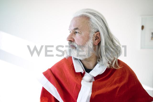 Bearded mature man wearing Santa costume looking sdeways - MOEF01002
