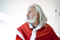 Bearded mature man wearing Santa costume looking sdeways - MOEF01002