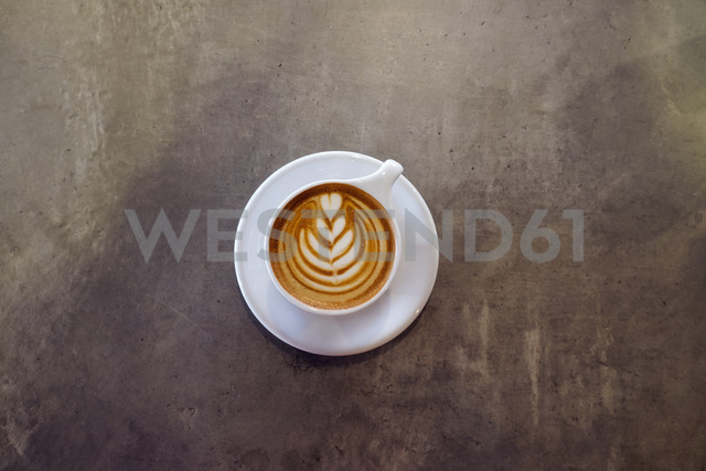 Overhead view of cappuccino on table at coffee shop - CAVF25148