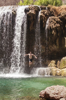 Man jumping from Havasu falls at Grand Canyon National Park - CAVF25169
