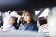 Brothers sitting in car seen through vehicle seat - CAVF25490