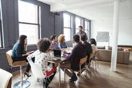 Businessman explaining colleagues in meeting room - CAVF25586