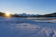 Italy, Abruzzo, Gran Sasso e Monti della Laga National Park, Lake Campotosto at sunrise in winter - LOMF00702