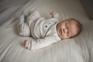 High angle view of baby boy sleeping on bed at home - CAVF26450