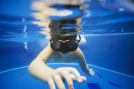 Girl swimming in pool - CAVF26785