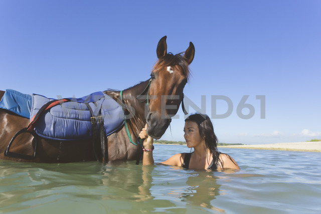 Indonesia, Bali, Woman with horse - KNTF01107