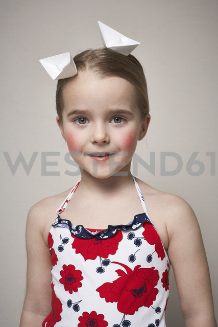 Portrait of little girl with two paper boats on her head - FSF01001