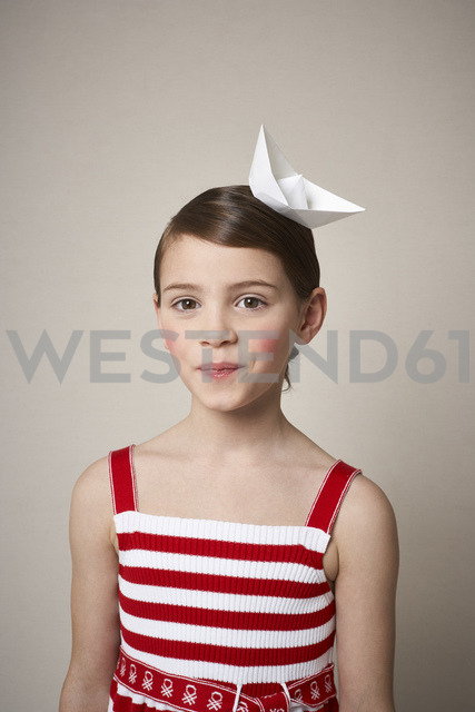 Portrait of little girl with paper boat on her head - FSF01004