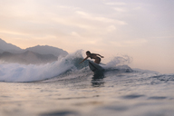 Indonesia, Sumatra, female surfer in the evening light - KNTF01119