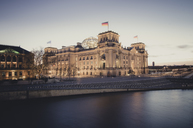 Germany, Berlin, Reichstag building at Spree river in the evening - STCF00495