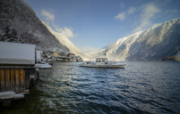 Austria, Salzkammergut, Hallstatt, Lake Hallstatt and ferry in winter - STCF00507