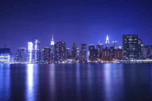 River against illuminated cityscape at night - CAVF27212