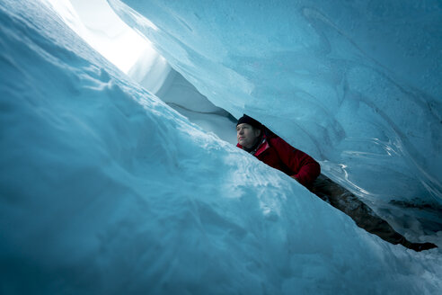 Hiker looking up while ice climbing at Jasper - CAVF27332