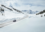 Austria, Tyrol, Sellrain Valley, Kuehtai, Car on mountain road in winter - CVF00318