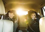 Portrait of boys sitting in car - CAVF27494
