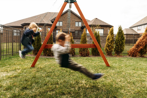 Boys playing on swings at yard - CAVF27500