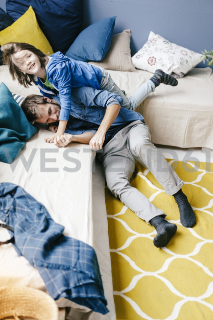 Father and son playing at home - KNSF03598