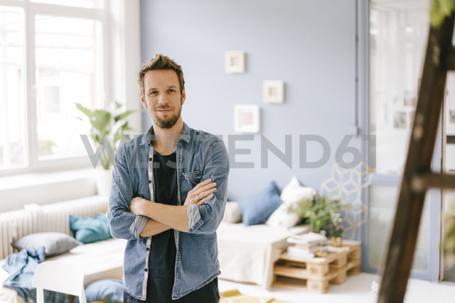 Portrait of smiling man at home - KNSF03622