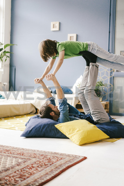 Happy father and son playing at home - KNSF03625