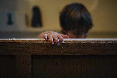 Boy in wooden bathtub at home - CAVF27610