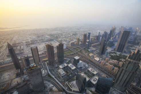 Aerial view of cityscape against sky during sunrise from Burj Khalifa - CAVF28087