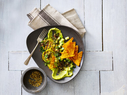 Guacamole with grilled green tomatoes, cucumber and tortilla chips - KSWF01844