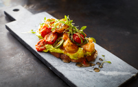 Crostini with shrimps and tomatoes, roasted bread, herbs, avocado cream, sweet chili sauce, jalapenos, cress - KSWF01865