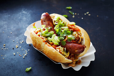 Asian hot dog, fried sausage, spicy chinese cabbage, hot chili sauce, spring onions, cress, bun - KSWF01868