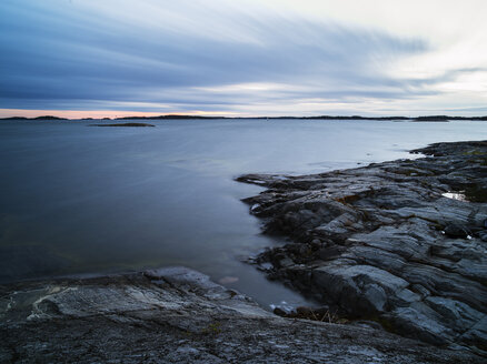 Rocky shore and calm sea at sunset - FOLF00085