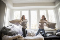 Pillow fight between two best friends at home - FMKF04997