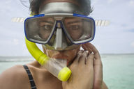 Portrait of woman with snorkel and diving goggles - ZEF15238