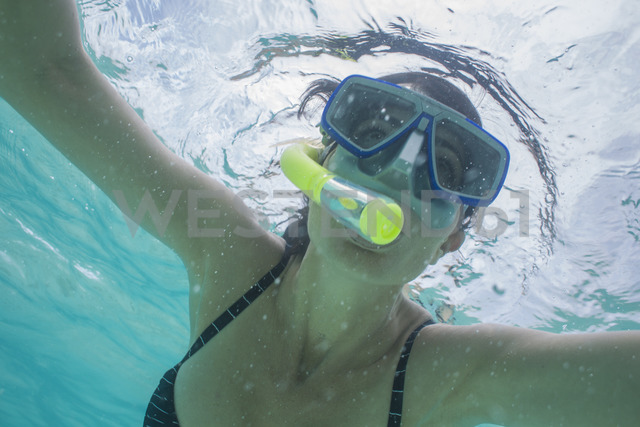 Portrait of woman snorkeling under water - ZEF15241