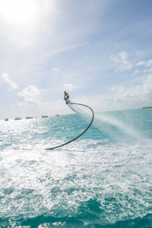 Maldives, man on flyboard above the sea - ZEF15253