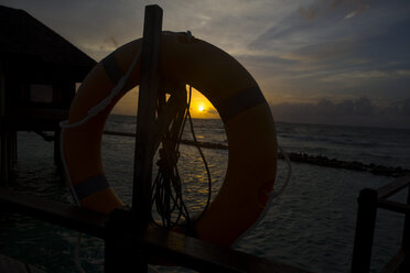 Maldives, lifebelt and sunset above the ocean - ZEF15256