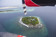 Maldives, seaplane above an island - ZEF15262