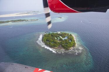 Maldives, seaplane above an island - ZEF15262