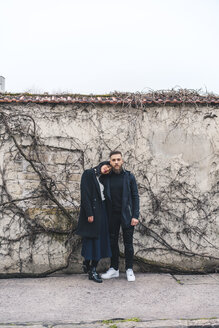 Young couple standing in front of wall - AFVF00359