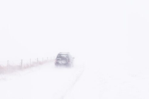 UK, Scotland, East Lothian, North Berwick, snowdrifts, off road vehicle during winter storm - SMAF00985