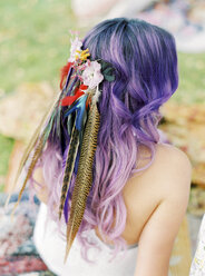 Bride with flowers and feathers in purple hair at hippie wedding - FOLF00441