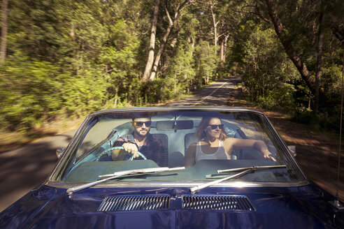 Couple driving car through forest - FOLF00579