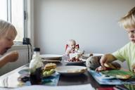Siblings having breakfast at table - CAVF28538