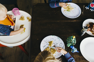 High angle view of siblings having breakfast at table - CAVF28541